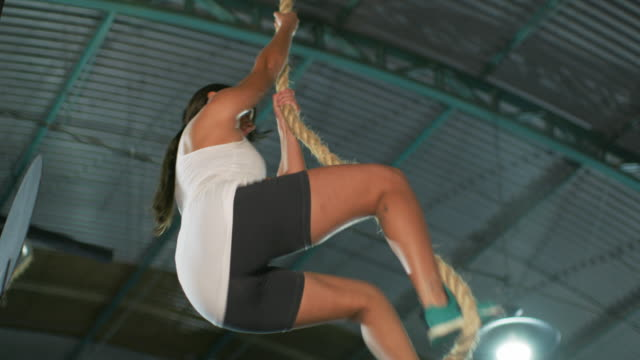 ms a woman climbs a rope in a gym / rio de janeiro, brazil - imperfection stock videos and b-roll footage