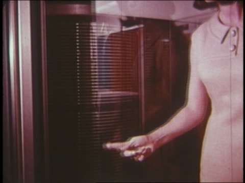 1965 woman closing glass door on computer - mainframe stock videos & royalty-free footage