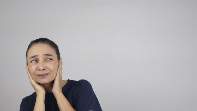 woman closing her ears hand cupped - human ear stock videos & royalty-free footage