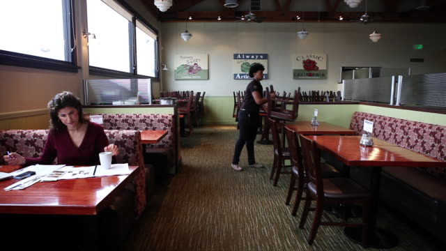 ws woman closing restaurant giving check to customer / truxton's, california, usa - closed stock videos and b-roll footage