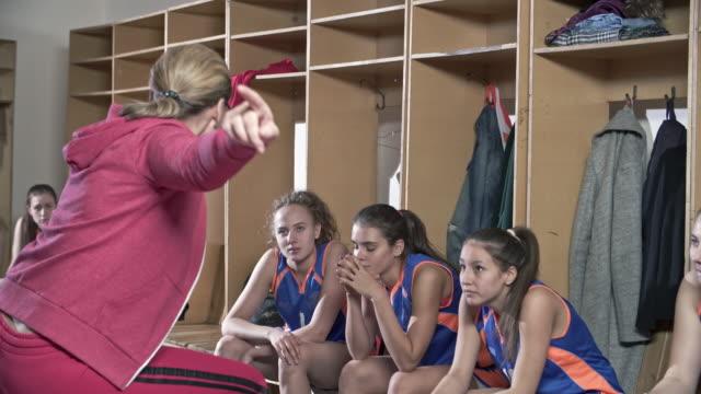 Woman coaching female basketball team