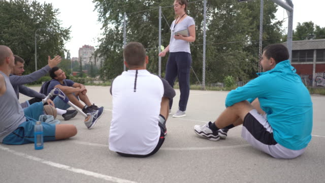 woman coaching male basketball team - role reversal stock videos & royalty-free footage