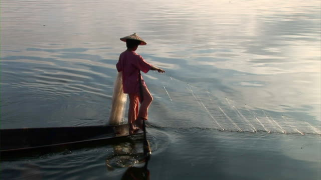 A woman collecting fishing net
