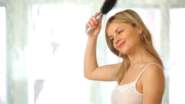 Woman combing a hair.