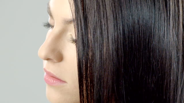 woman combing her hair - straight hair stock videos & royalty-free footage