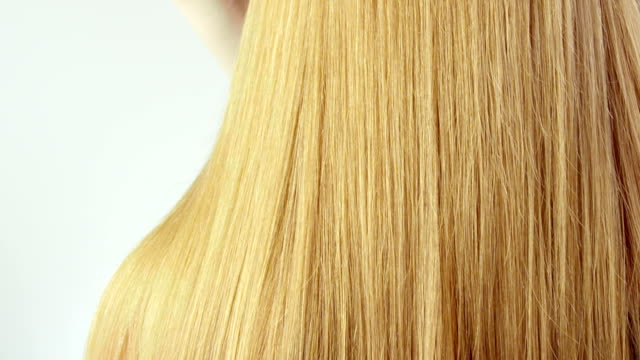 woman combing her hair. - blonde hair stock videos & royalty-free footage