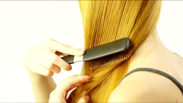 woman combing her hair. - straight hair stock videos & royalty-free footage