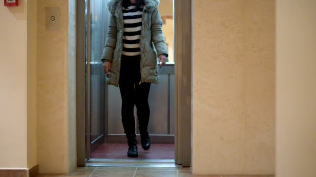 woman comes out of the elevator - lift stock videos & royalty-free footage