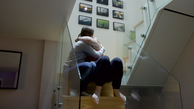 woman comforting her upset teenage daughter - staircase stock videos & royalty-free footage