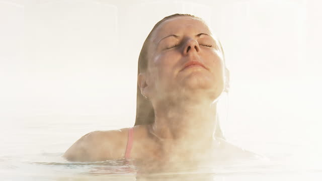 hd slow motion: woman coming out of hot tube - varm källa bildbanksvideor och videomaterial från bakom kulisserna