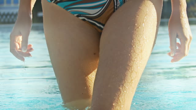 hd slow motion: woman coming out of the pool - digital enhancement stock videos and b-roll footage