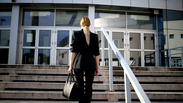 woman coming to work - purse stock videos & royalty-free footage