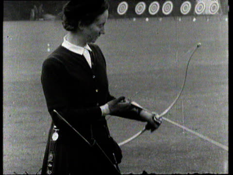 Woman competes in archery tournament at Worcester College Oxford 1954