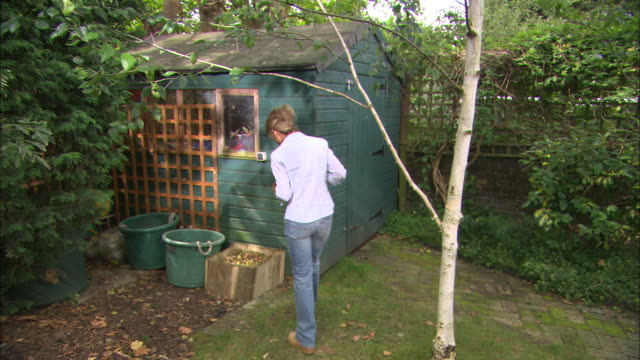 ws woman composting potato peel - shed stock videos & royalty-free footage
