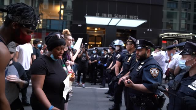 a woman confronts police during a demonstration to protest the recent death in minneapolis of george floyd who died after a police officer was filmed... - george floyd stock videos & royalty-free footage
