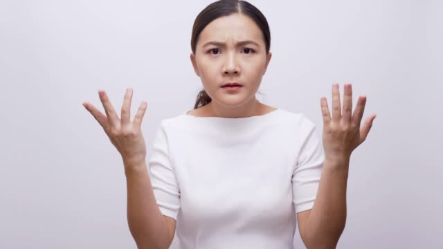 Woman confused look at camera on isolated blue background 4k