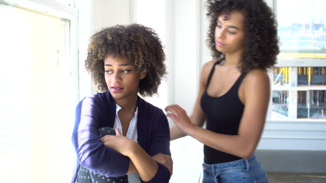 woman consoling her friend - support stock videos & royalty-free footage