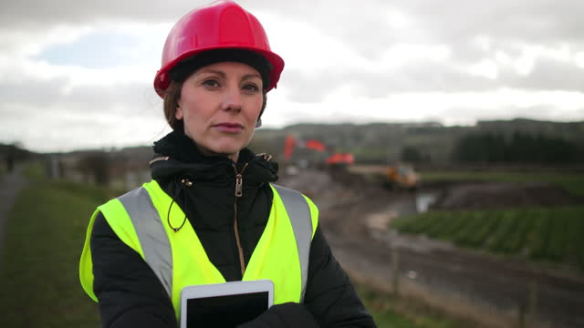 woman construction worker - image stock videos & royalty-free footage