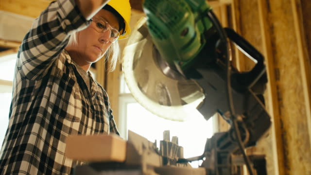woman construction worker - carpenter stock videos & royalty-free footage