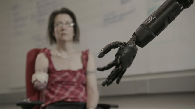 woman controls bionic arm - prosthetic equipment stock videos & royalty-free footage