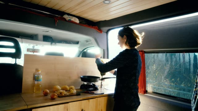 Woman cooking fried potato in the van