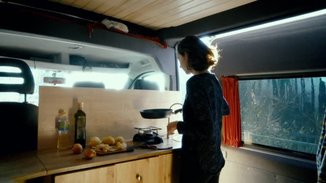 woman cooking fried potato in the van - van vehicle stock videos and b-roll footage