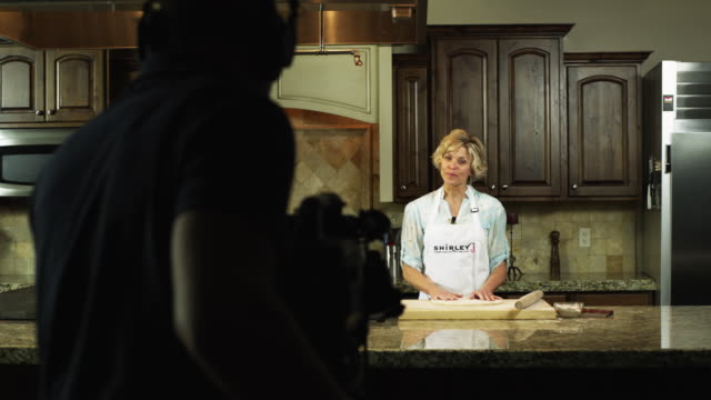 MS TD Woman cooking in TV studio and being filmed / Orem, Utah, USA