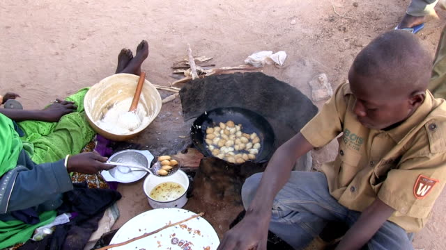 Woman cooking on the street Niger Agadez