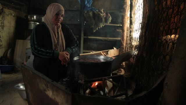 A woman cooks in her house in a poor area of Gaza on October 23 2016