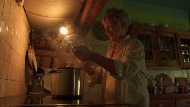 woman cooks soup - one senior woman only stock videos & royalty-free footage