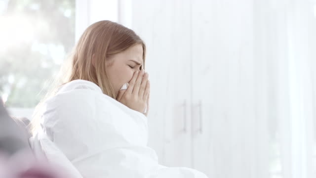 woman coughing and sneezing at home - duvet stock videos & royalty-free footage