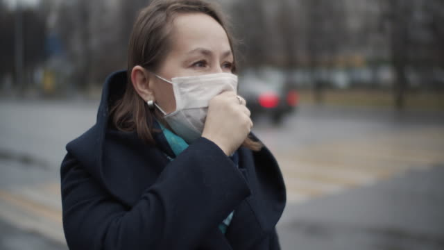 woman coughing in protective medical mask - air pollution stock videos & royalty-free footage