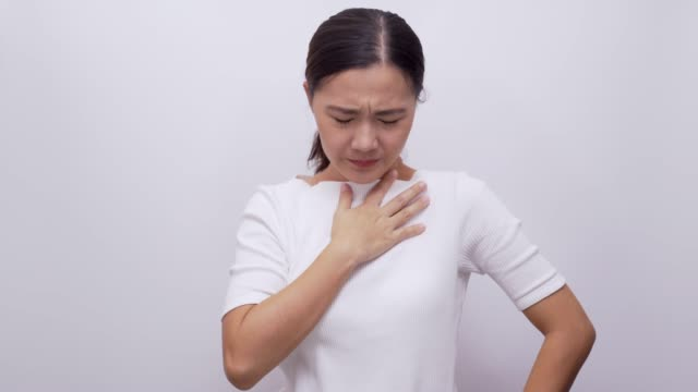 woman coughing on isolated white background 4k - pollen stock videos & royalty-free footage