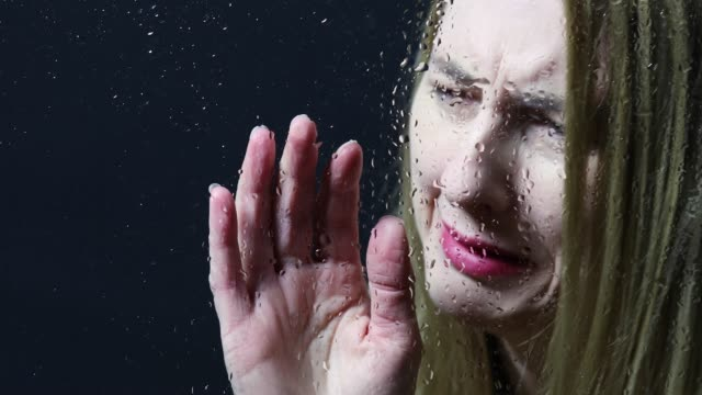woman crying by wet window - shower videos stock videos & royalty-free footage