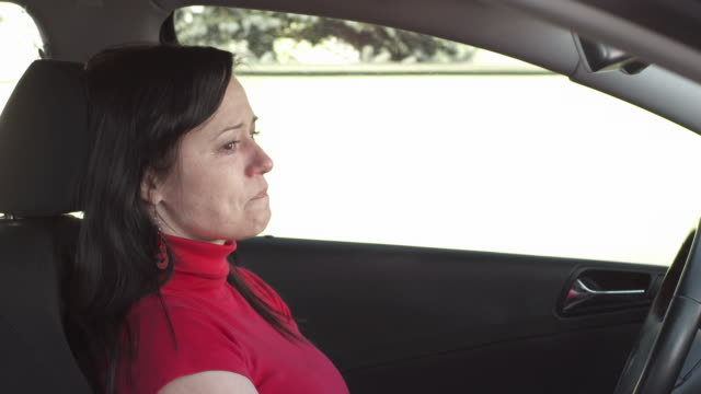 hd: woman crying in a car - grief stock videos & royalty-free footage