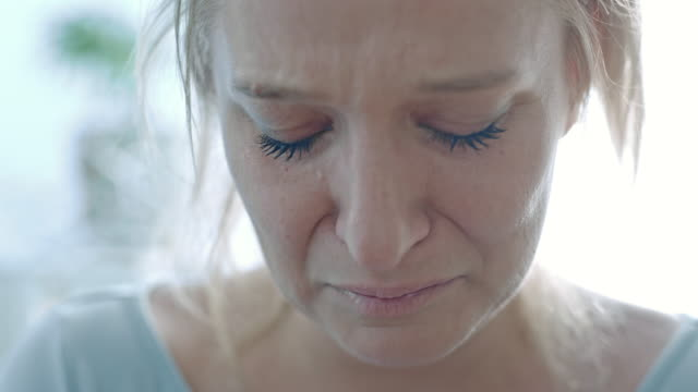 slo mo woman crying in sadness - violence stock videos & royalty-free footage