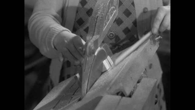 woman cuts wood on circular saw; 1956 - offbeat stock videos & royalty-free footage