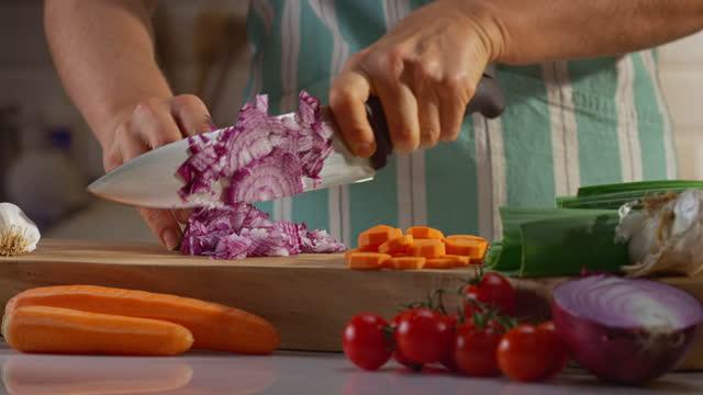 woman cutting a red onion - medium shot stock videos & royalty-free footage