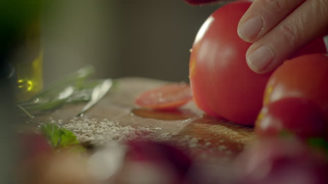 woman cutting a tomato into slices - chopping board stock videos & royalty-free footage