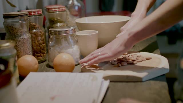 woman cutting almonds - アーモンド点の映像素材/bロール