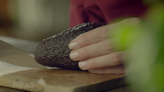 woman cutting avocado - cutting stock videos & royalty-free footage