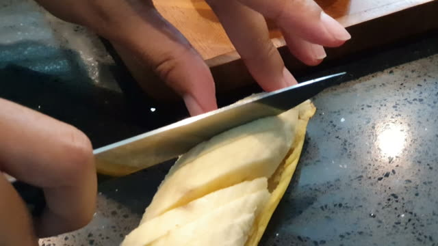 woman cutting banana at home kitchen - part of stock videos & royalty-free footage