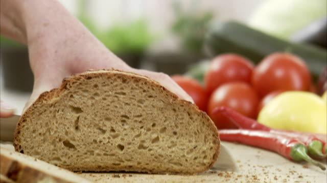 Woman cutting bread, Sweden.