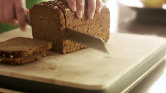 woman cutting bread, sweden. - comfort food stock videos & royalty-free footage