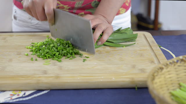 woman cutting chives - chive stock videos & royalty-free footage