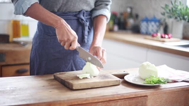 Woman cutting fennel bulb