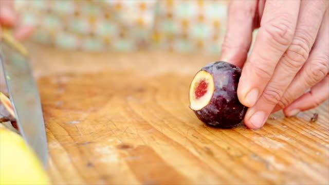 Woman cutting fig