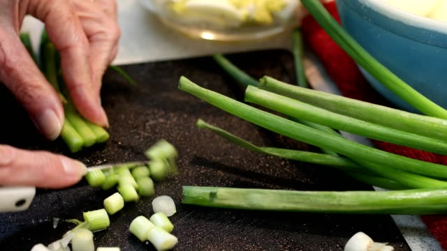 woman cutting green onions. - chopped stock videos and b-roll footage