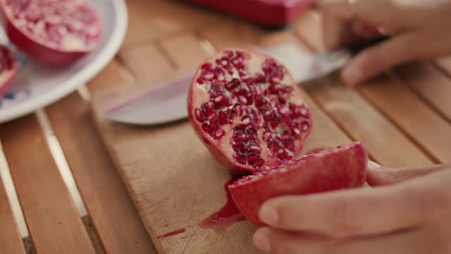 woman cutting pomegranate in half - peel stock videos & royalty-free footage