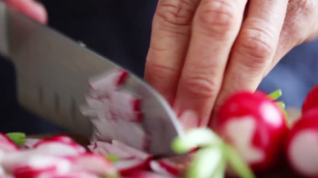 Woman cutting radishes